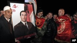 Supporters of former ethnic Albanian rebel commander and former Kosovo Prime Minister Ramush Haradinaj, await his arrival in capital Pristina, Kosovo on Thursday, Nov. 29, 2012.