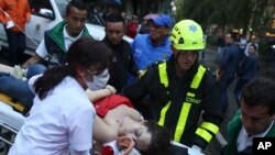 An injured woman is evacuated on a gurney after an explosion at the Centro Andino shopping center in Bogota, Colombia, June 17, 2017.