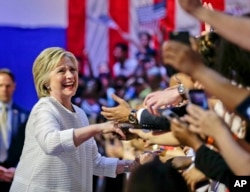 Democratic presidential candidate Hillary Clinton greets supporters during a rally on June 7, 2016.