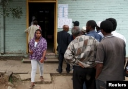 A woman leaves after casting her vote at a polling station, as Ethiopia's national election kicks off in capital Addis Ababa, May 24, 2015.