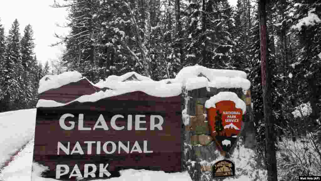 Snow covers the entrance sign to Glacier National Park in December, 2012 in West Glacier, Montana.