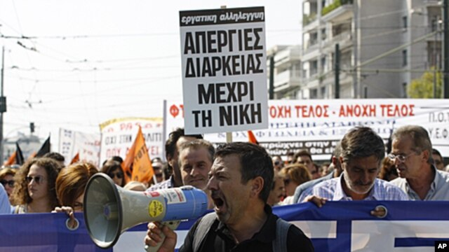 Protesters shout slogans during demonstration in Athens, Oct. 5, 2011.