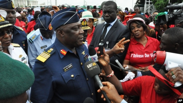 Nigeria's Chief of Defense Staff Air Marshal Alex Badeh, speaks during a demonstration calling on the government to rescue the kidnapped girls, Abuja, Nigeria, May 26, 2014.