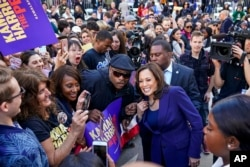 FILE - Supporters take photos with U.S. Sen. Kamala Harris after she formally launched her presidential campaign at a rally in her hometown of Oakland, California, Jan. 27, 2019.