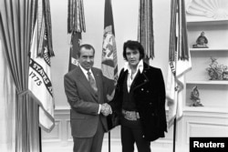 President Richard Nixon shakes hands with Elvis Presley in the Oval Office in Washington, D.C., in December 1970.