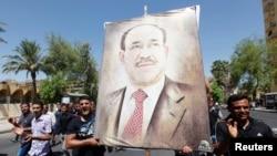 2014年8月11日伊拉克人举着马利基肖像游行