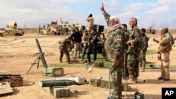 Pasukan Irak dan milisi Syiah mempersiapkan serangan di pinggiran kota Tikrit (4/3).