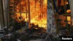 Fire consumes a clothing stall after an explosion at a shopping complex in Nairobi, Kenya, May 28, 2012.