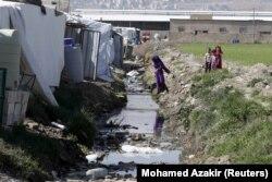 Lağım kanalının yanında kamp kuran Suriyeli mülteciler
