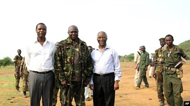 A picture released by Thabo Mbeki's spokesman shows former President of Burundi Pierre Buyoya and AU mediator for the Sudan crisis Thabo Mbeki  with Sudan People's Liberation Army (SPLA) commander, Abdel Aziz al-Hilu (C), at his military headquarters in S
