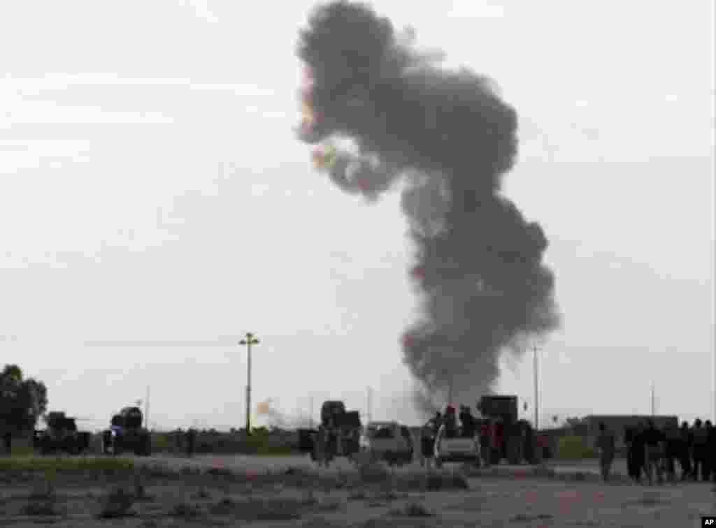 Smoke rises from an explosion as Iraqi forces, Shiite militiamen and Sunni tribal fighters battle Islamic State militants for control of Tikrit, Iraq, March 3, 2015.