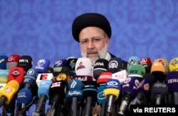 FILE - Iran's President-elect Ebrahim Raisi speaks during a news conference in Tehran, Iran, June 21, 2021.