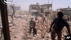Nhà cửa đổ nát vì các cuộc oanh kích của chính phủ ở Qusair, trong tỉnh Homs của Syria