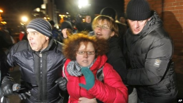Belarus plainclothes policemen detain protesters during an opposition action devoted to the anniversary of the presidential election in Belarus, Minsk,  Dec. 19, 2011.
