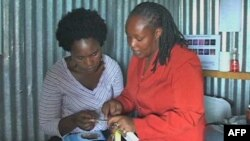 Health education translators like Susan Mwangi, right, in Kenya have to choose their words carefully to avoid offending cultural sensitivities