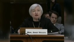 New Fed Chief Faces Reporters
