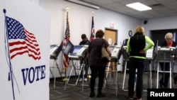 FILE - Some voters in Medina, Ohio, cast their ballots early, on Oct. 26, during the 2012 U.S. presidential election. Most U.S. states allow early voting.