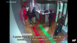 "This image taken from surveillance camera shows a still image of people inside Ataturk International Airport, Istanbul, Turkey, on Oct. 2, 2018. The text on the screen from source in Turkish reads: ""nine people enter from airport's E Gate on Oct. 2, 2018 around 03:37."""