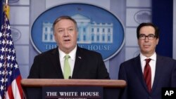 Secretary of State Mike Pompeo and Treasury Secretary Steve Mnuchin brief reporters about additional sanctions placed on Iran, at the White House, Jan. 10, 2019, in Washington.