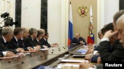 President Vladimir Putin heads a meeting of Russia's Security Council in Moscow's Kremlin July 22, 2014. Nikolai Patrushev is the third from the left.