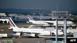 FILE - Orly airport, France, Sept. 18, 2014.