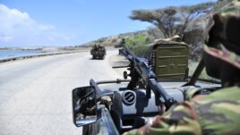 Soldiers patrol the seaport in Somalia's southern port city of Kismayo, November 29, 2012.