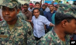 FILE - Maldivian President Abdulla Yameen, center, surrounded by his body guards arrives to address his supporters in Male, Feb. 3, 2018.