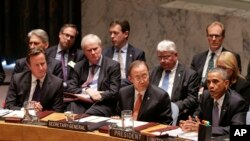 President Barack Obama speaks during a United Nations Security Council meeting, as United Kingdom Prime Minister David Cameron (L) and U.N. Secretary General Ban Ki-moon listen, at U.N. headquarters in New York, Sept. 24, 2014.