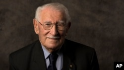 In this undated photo provided by the Sydney Jewish Museum, Holocaust survivor Eddie Jaku poses for a photograph in Sydney, Australia.