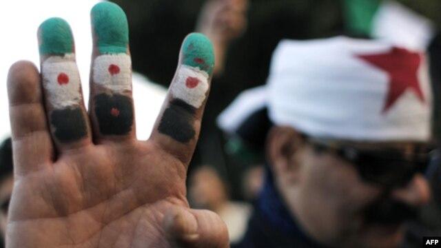 Biểu tình bên ngoài trụ sở của Liên đoàn Ả Rập ở Cairo, Ai Cập, ngày 22/1/2012