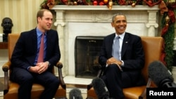 U.S. President Barack Obama, right, meets Britain's Prince William in the Oval Office of the White House in Washington, Dec. 8, 2014.