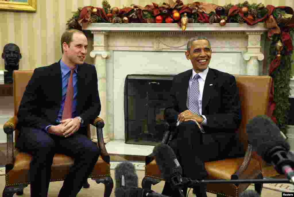 U.S. President Barack Obama meets Britain's Prince William in the Oval Office of the White House in Washington, Dec. 8, 2014.