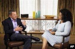 FILE - Talk-show host Oprah Winfrey interviews cyclist Lance Armstrong in Austin, Texas, January 14, 2013.