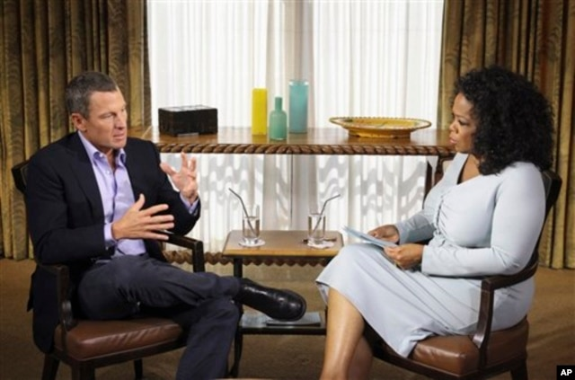 FILE - Talk-show host Oprah Winfrey interviews cyclist Lance Armstrong in Austin, Texas, January 14, 2013.