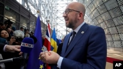 Belgian Prime Minister Charles Michel speaks with reporters as he arrives for an EU summit in Brussels, April 29, 2017.