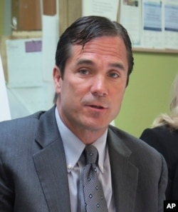 FILE - Nick Lyon, Michigan Health and Human Services director , June 5, 2017. Lyon has been charged with involuntary manslaughter in a criminal investigation of Flint's lead-contaminated water.