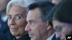 Managing Director of the International Monetary Fund Christine Lagarde, left, attends the plenary session of the World Economic Forum in Davos, Switzerland, Jan. 20, 2016.