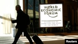 FILE - An attendee leaves the Congress Hall during the World Economic Forum (WEF) annual meeting in Davos, Switzerland, Jan. 20, 2017.