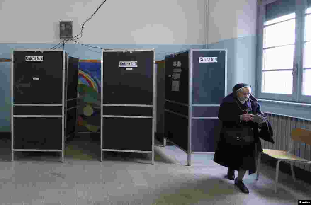 A nun casts her vote in a polling station in Rome, Feb. 24, 2013.