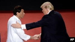 Philippines President Rodrigo Duterte, left, shakes hands with U.S. President Donald Trump during an ASEAN Summit, in Manila, Philippines, Nov. 13, 2017.