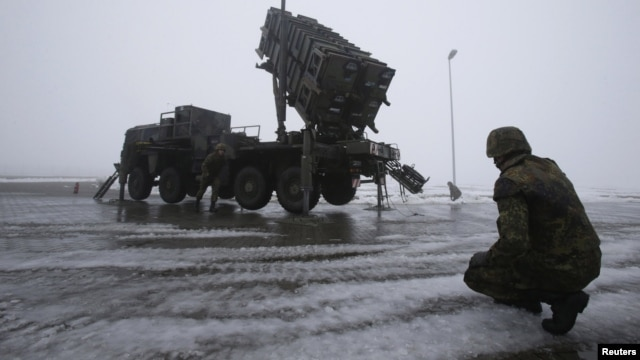 German troops beside a Patriot missile battery during a media rehearsal, Warbelow, Dec. 18, 2012.