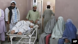 A wounded man is transported at a hospital after a roadside bomb blast in the Panjwai district of Kandahar May 24, 2011