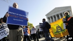 Health care law proponents (L) walk past opponents from the Tea Party Patriots group (R) on the sidewalk outside ongoing legal arguments over the Patient Protection and Affordable Care Act at the Supreme Court in Washington, March 26, 2012.