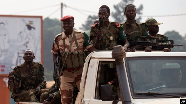 FILE - Chadian troops, part of an African Union peacekeeping force, drive down a road in Bangui, Central African Republic.