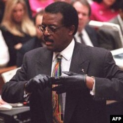 Defense lawyer Johnnie Cochran put on a pair of gloves to demonstrate a point to the jury in the O.J. Simpson murder trial in 1995. A bloody glove had been found at the murder scene, and another outside Simpson's house.