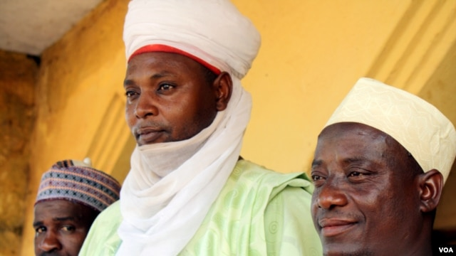 "Sani Umar (center) is the ""Sarkinyekin Gagi,"" which means the ""Great Warrior of Gagi."" This title has been in his family for centuries but Nigerian royalty lost formal powers when the British colonials took over. (H. Murdock/VOA)"