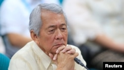 Philippine Foreign Secretary Perfecto Yasay gestures during a commission on Appointment hearing at the Senate headquarters in Pasay city, metro Manila, March 8, 2017.