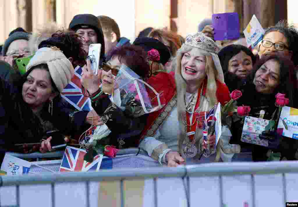 Well-wishers wait to greet Britain's Prince William and Catherine, the Duchess of Cambridge, as they make a visit to Coventry.
