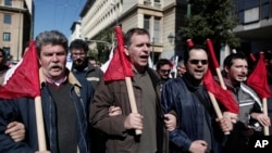 Members of pro-communist union PAME shout slogans during a protest in Athens, February 20, 2013.