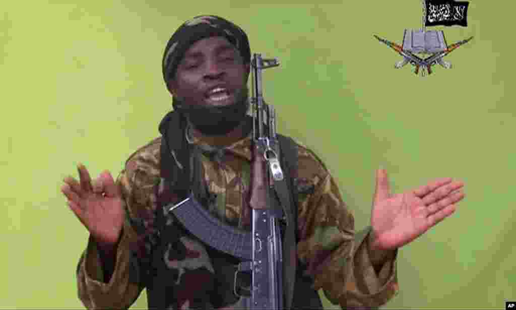 Abubakar Shekau, leader of Boko Haram, speaks to the camera in a video released by the extremist militant group, May 12, 2014.
